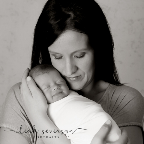 carmel newborn baby smiles during portrait session