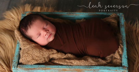 newborn portraits of noah in indianapolis in a blue box
