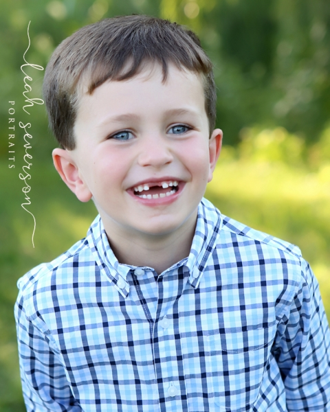 photograph outdoor in carmel indiana of andrew smiling