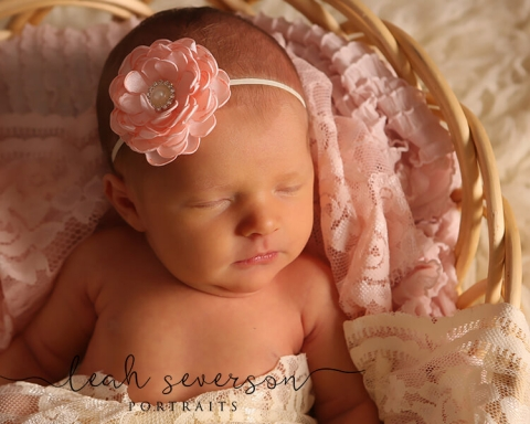 newborn baby on pink blanket