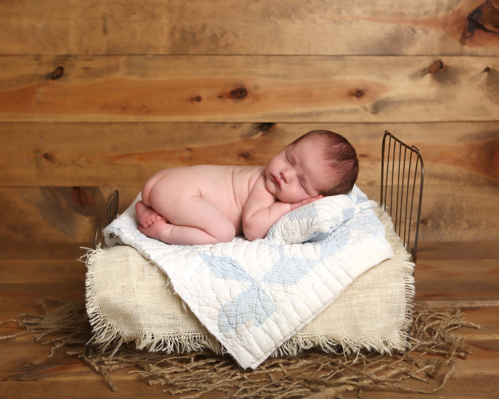 newborn-baby-in-bed