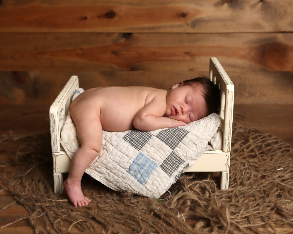 newborn-bed-photography-boy-quilt