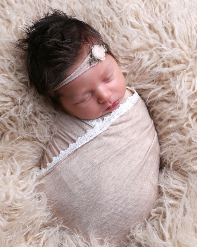 newborn-girl-wearing-taupe-wrap