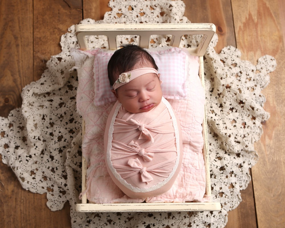 newborn-photography-bed-indianapolis-pink
