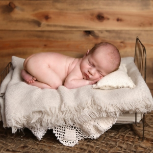 newborn-twin-photography-baby-on-bed