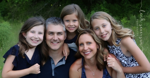 family snuggles during outdoor portrait session