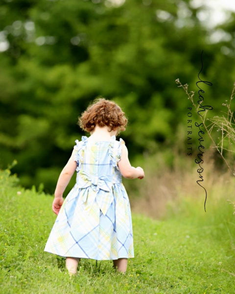 childrens-photography-carmel-in-elise-walkihng-up-hill