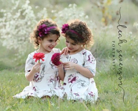 girls play during professional photographer session in carmel indiana with flowers
