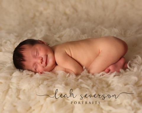 newborn-baby-smiling-photograph-carmel-in-madison