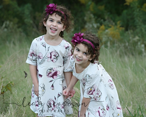 laila and nicole giggle for childrens photographer during outdoor portrait session in indianapolis