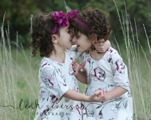laila and nicole snuggle with carmel, indiana childrens photographer outdoor in flower field