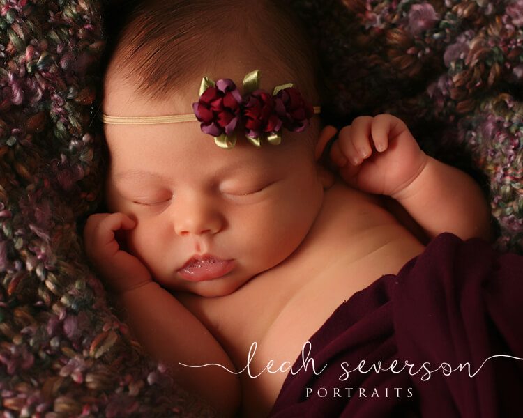 indianapolis baby photographer halle wearing purple flowers