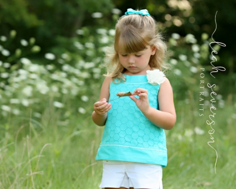 carmel-childrens-photographer-grace-with-flower-looking