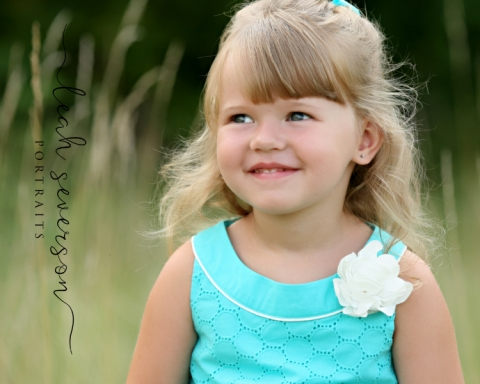 childrens-photographer-carmel-grace-smiling-looking-from-camera