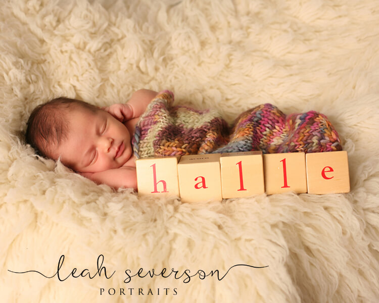 newborn photographer carmel baby halle with letter blocks