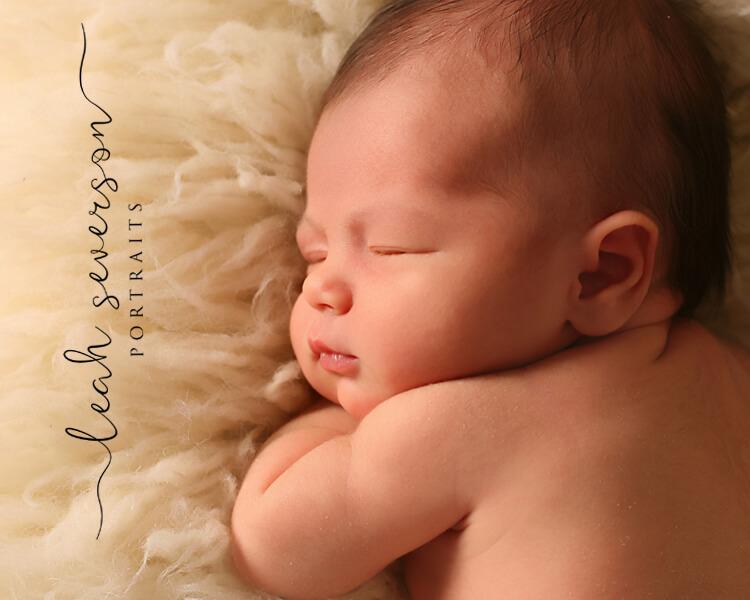 newborn photographer indianapolis halle sleeping on white fluffy blanket