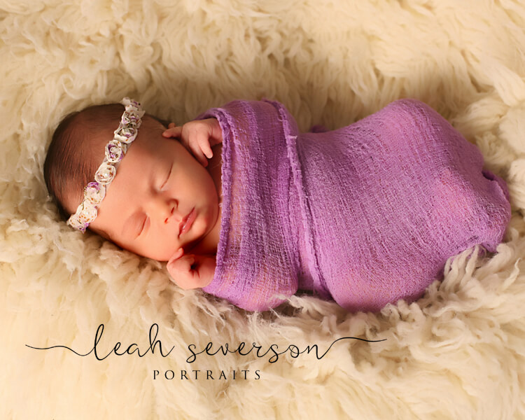 carmel newborn photography halle wrapped in purple blanket