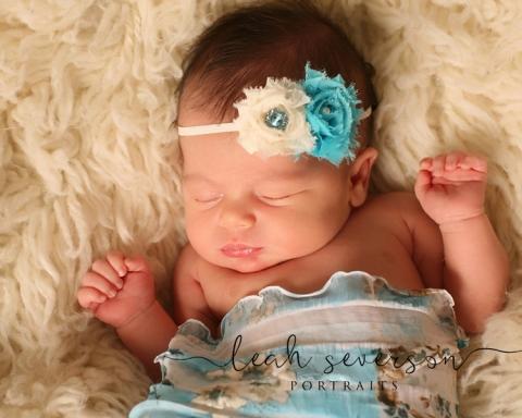 newborn photographer westfield halle sleeping with blue flowers in hair