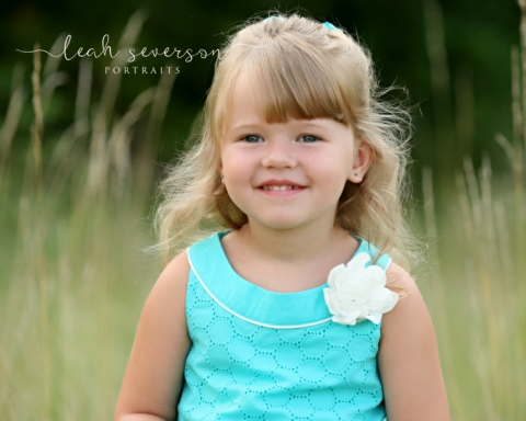 westfield-childrens-photographer-grace-smiling-in-field