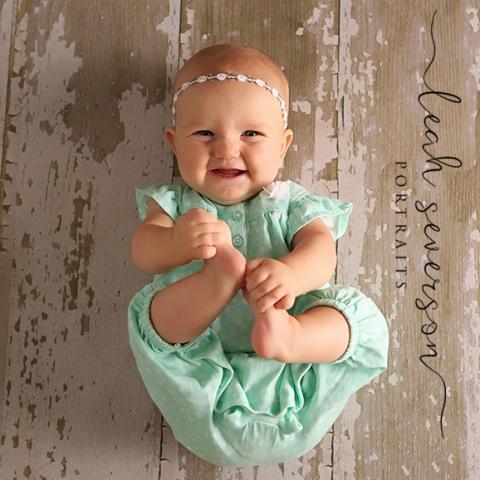 photograph of baby charlotte grabbing toes