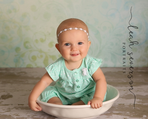 baby charlotte sits in bowl