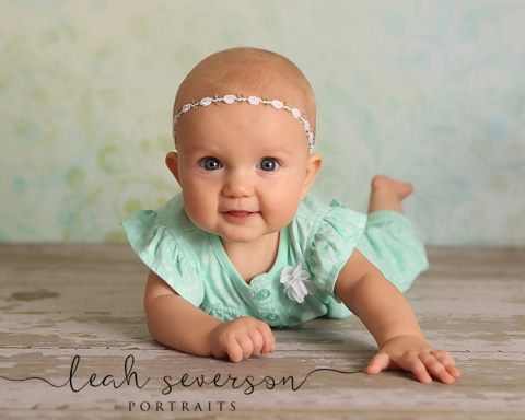 photograph of baby charlotte wearnig mint green