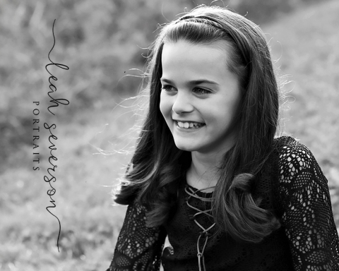 sydney giggling during outdoor fall portrait session