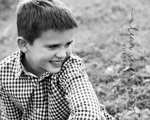 photograph of chase sitting in grass at carmel portrait studio