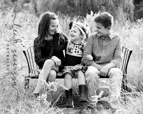 giggling children get photograph taken outdoors in carmel