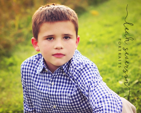 photography of child outdoors in blue shirt