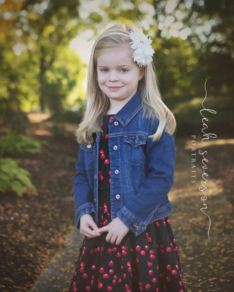photography of hailey in fall leaves
