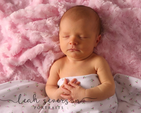 newborn photography of baby amelia in indianapolis with pink flowered blanket