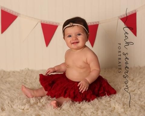 newborn baby in carmel in wearing red tutu