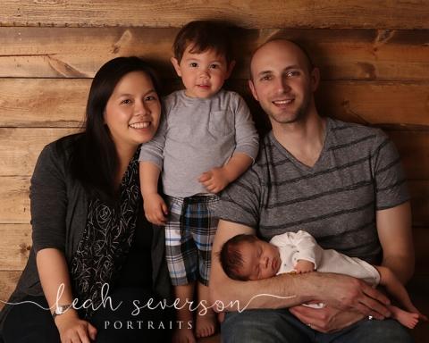 newborn baby with family portrait