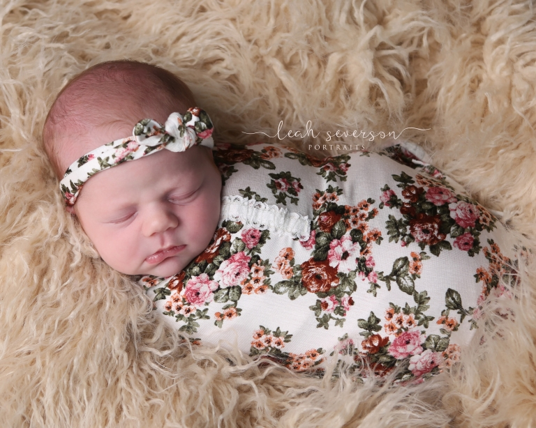 baby wearing floral newborn wrap