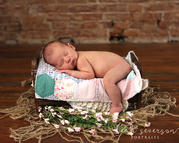 newborn photography indianapolis baby in bed