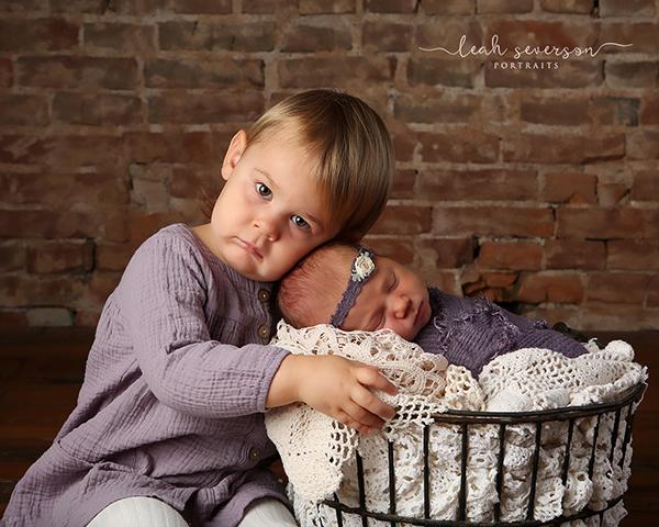newborn baby snuggling big sister photograph indianapolis