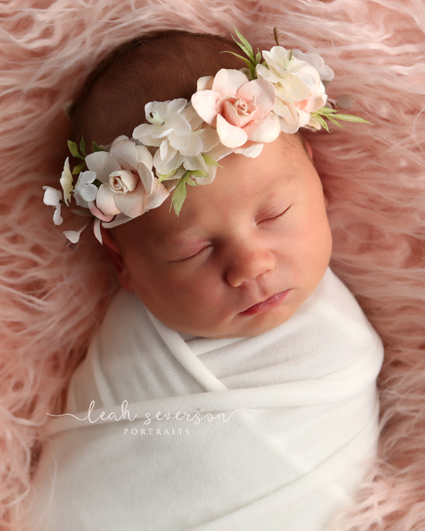 newborn baby sleeping on pink fur photograph
