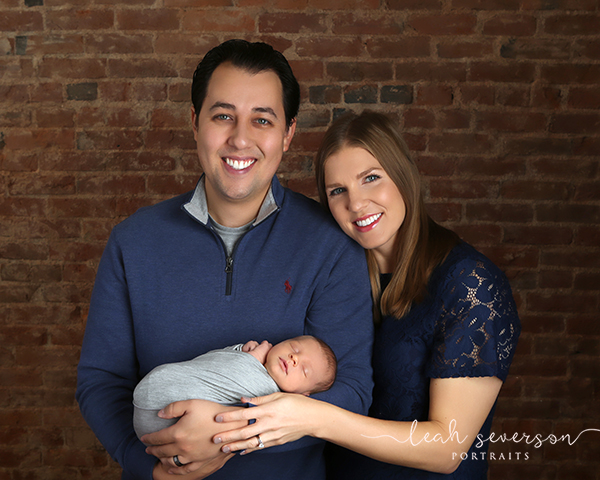family photograph of newborn and parents carmel indiana
