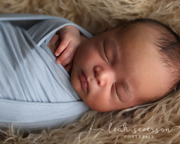 newborn photography baby in wrap